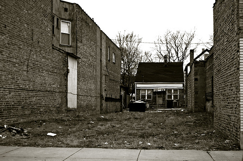 House behind vacant lot, 2008, by Samuel A. Love, CC by-NC-ND 2.0