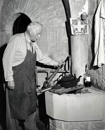 Jung pumping water at Bollingen ca. 1960.  Library of Congress