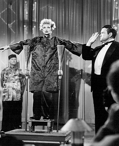 Lucille Ball and Orson Welles.From a 1956 episode. Public domain.