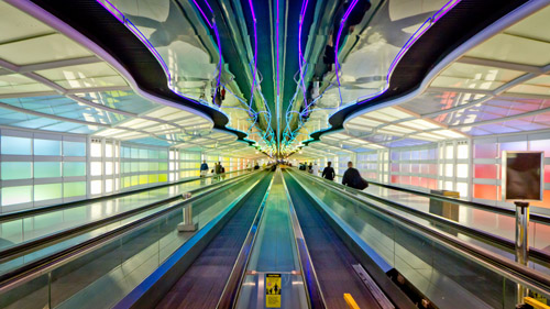 Neon passageway, O'Hare Airport, 2013 by Nicola. CC By 2.0